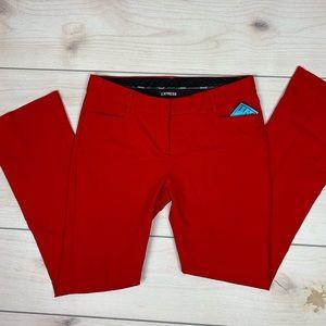 Express red bootcut work pants.